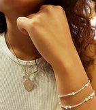 Armband van zilver met licht blauwe kralen en buisjes_