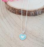 Zilveren ketting met een turquoise/zilver hartje_