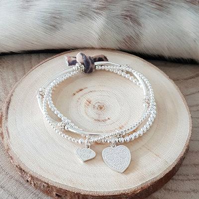 Setje zilveren armbanden met bedels