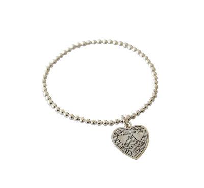Zilveren armband van elastiek met hart met hartjes