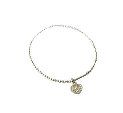 Zilveren armband van elastiek met klein hartje
