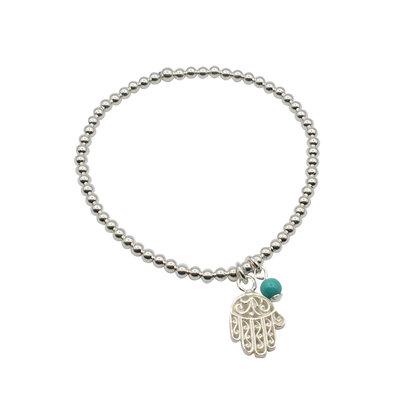 Zilveren armband met een klein hamsa handje