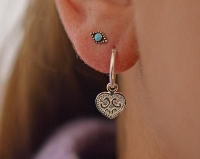 Zilveren oorringetjes met hip hartje