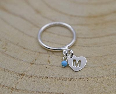 Zilveren ring met letter
