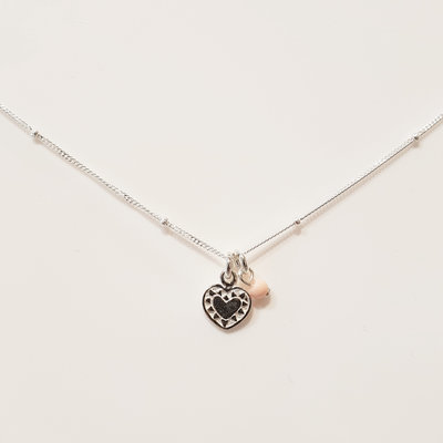 Zilveren ketting met hartje en kraal