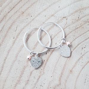 Zilveren oorbellen met hartje