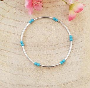 Armband van zilver met turquoise kralen