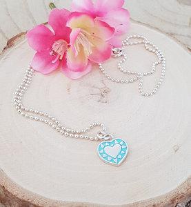 Zilveren ketting met een turquoise/zilver hartje