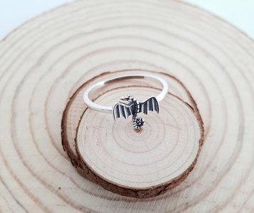 Zilveren ring met een draak