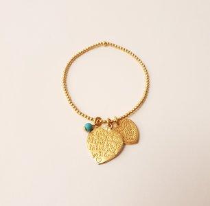 Gouden armband met hartjes