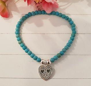Zilveren armband met turquoise kralen